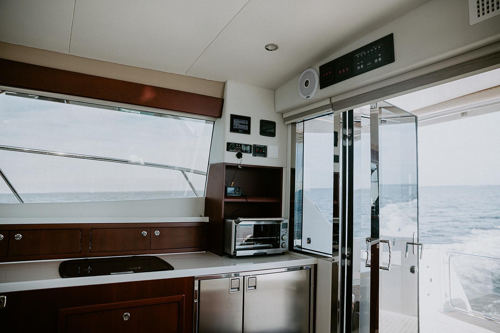 ArrowCat Power Catamarans displaying galley countertops and refrigerator